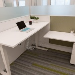 Height Adjustable Table within Workstation at Happy Family Brands Office in Boise, ID