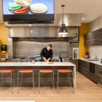 Chef Preparing Food in Front of Business Kitchen Furniture for Office